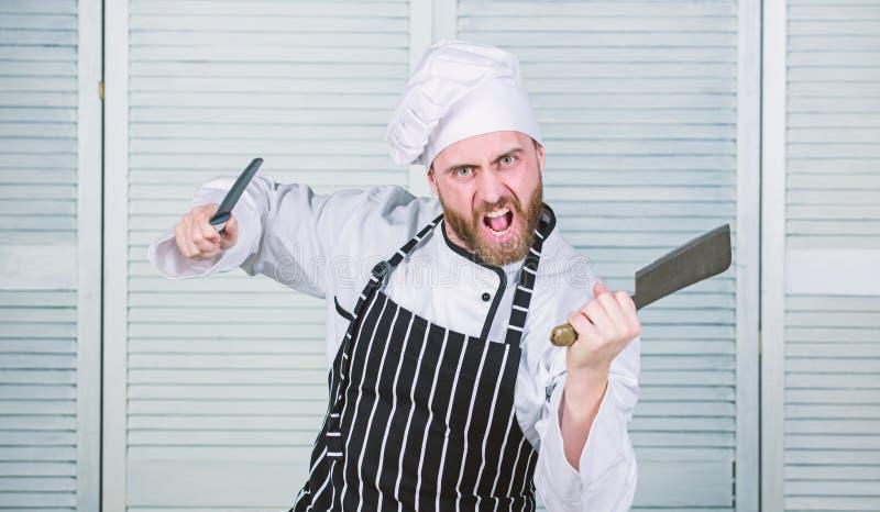 Hij is een kampioen in de keuken boze gebaarde mens met mes Liefdevoedsel Kok in restaurant chef-kok klaar voor het koken stock afbeeldingen