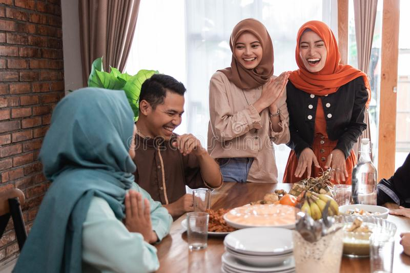 The Hijrah family together enjoy the iftar meal stock images