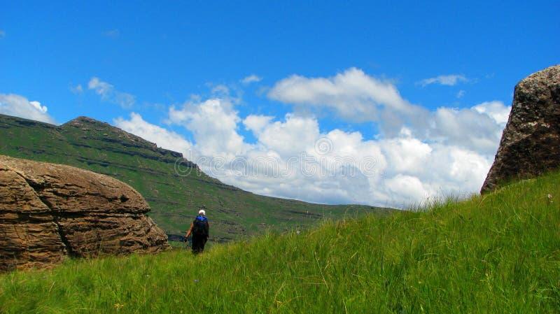 Hike in drakensberg. Boy is walking in Ukhahlamba Drakensberg park stock photo