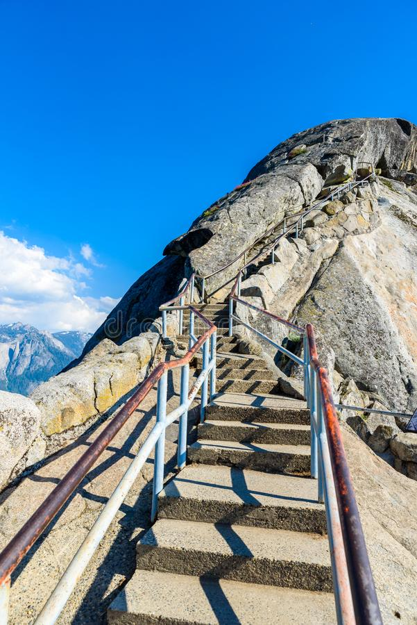 Hike on Moro Rock Staircase toward mountain top, granite dome rock formation in Sequoia National Park, Sierra Nevada mountains, stock image