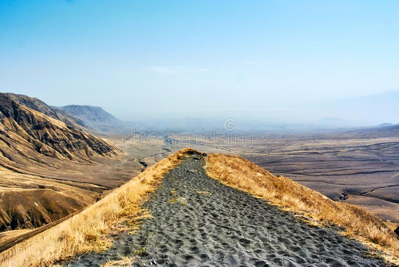 African scenery volcano hike in Crater Highlands. Hike in Ngorongoro Conservation Area Nationnal park Highlands with Masai Guide stock image