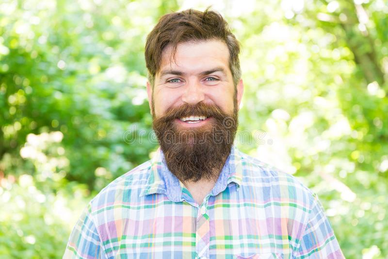 Hike and travel. United with environment. Handsome lumberjack. Man beard and mustache in summer forest. Summer vacation. Concept. Man bearded hipster green royalty free stock photography