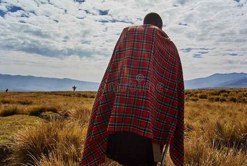 Masai guide hike in the mountains. Hikein Ngorongoro Conservation Area Nationnal park Highlands craters en route for Bulati Village from Nainokanoka with Masai stock photo