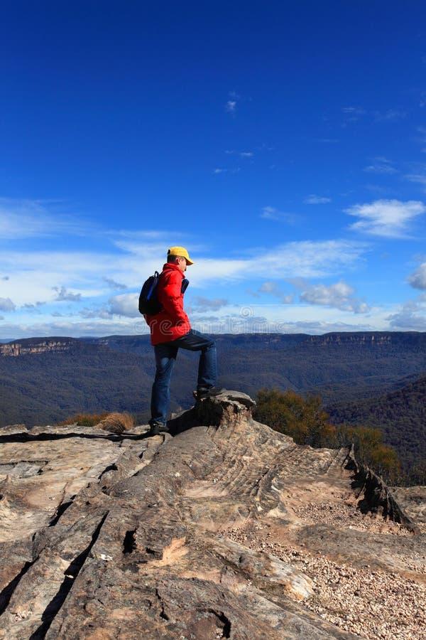 Hiker admiring mountain views. A hiker admires mountain views from Flat Rock Wentworth Falls Australia royalty free stock photos