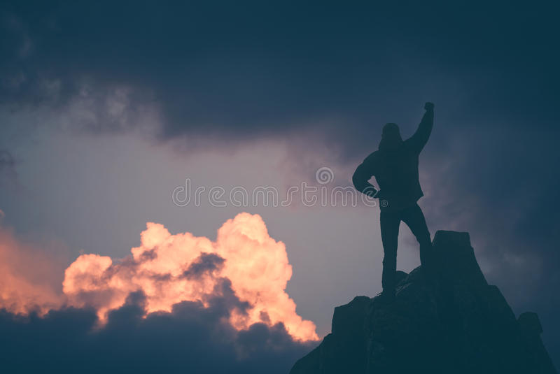 Hiker against sunset sky. Instagram stylisation royalty free stock photo