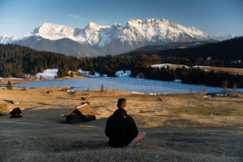 Hiker on alpine lake, Bavaria
