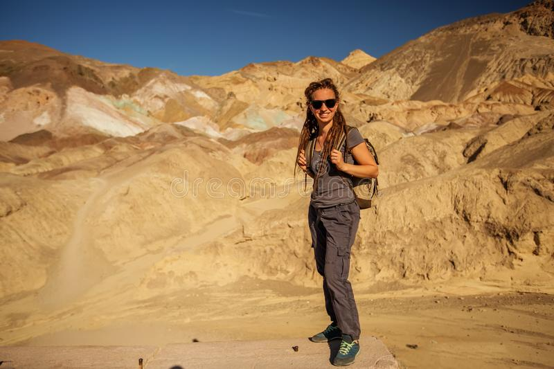 A hiker in the Artist`s Palette landmark place in Death Valley National Park, Geology, sand.  royalty free stock photos