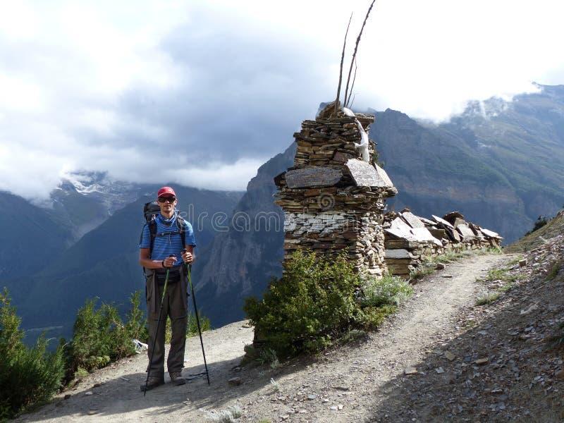 Hiker in autumnal Himalaya. Annapurna Circuit trek in Nepal, Marsyangdi river valley near Ngawal village royalty free stock photos