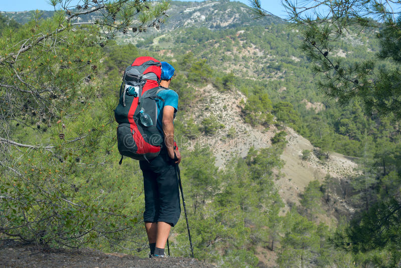 Hiker with backpack. Back view. stock photos