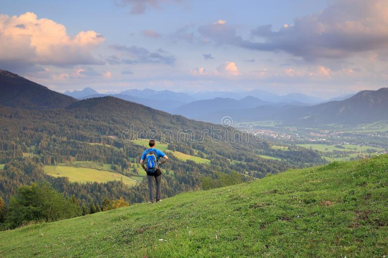 Hiker with backpack. Is viewing to mountains stock photos