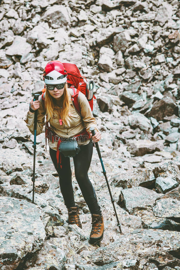 Hiker with backpack in mountains. Travel Lifestyle adventure concept active vacations outdoor hiking mountaineering trail running sport stones on background stock photo