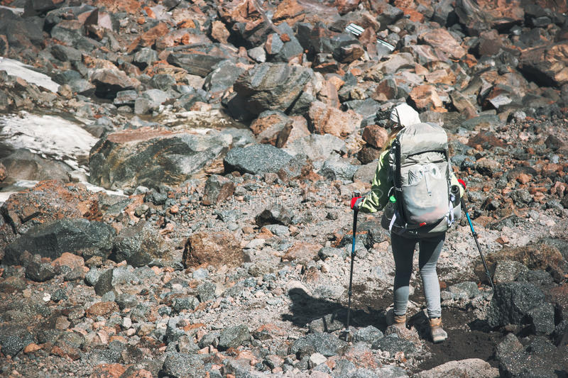 Hiker with backpack in mountains Travel Lifestyle. Adventure concept active vacations outdoor hiking mountaineering trail running sport stones on background stock photography