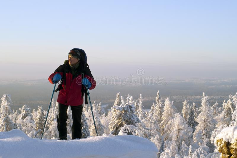 Traveler rises to the top of the mountain in winter royalty free stock photos