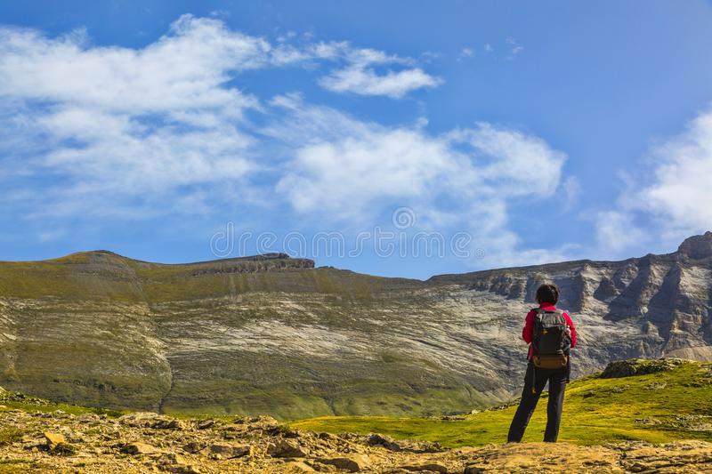Hiker in the Circus of Troumouse - Pyrenees Mountains stock image