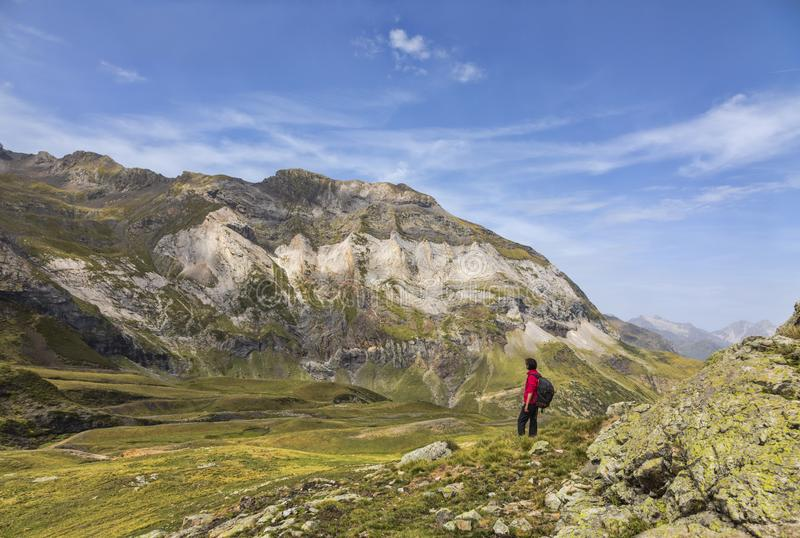 Hiker in the Circus of Troumouse - Pyrenees Mountains stock images