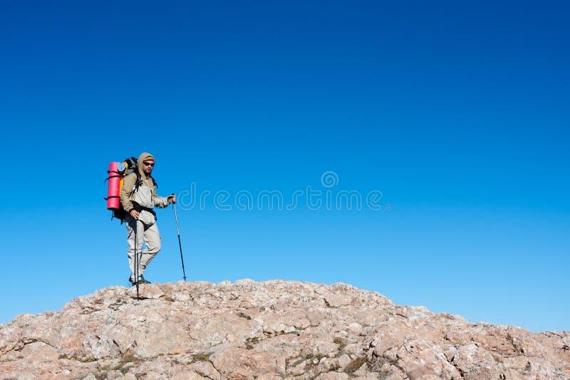 Hiker is climbing mountain stock photos