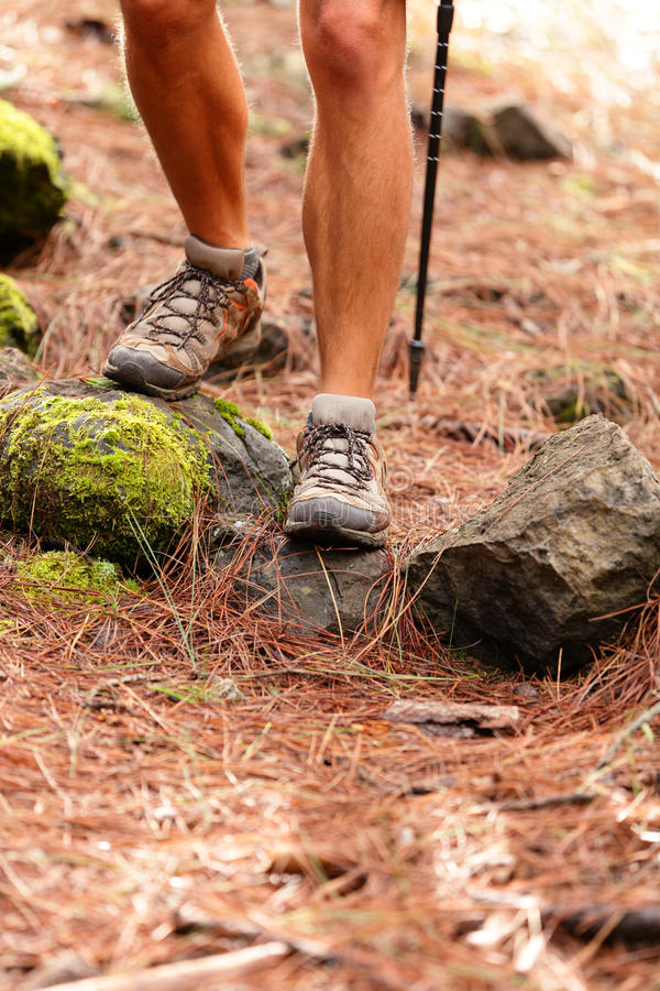 Hiker - close up of male hiking shoes and boots. Man on hike in forest stock images