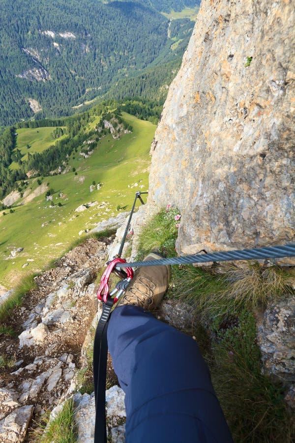 Via Ferrata. Hiker in Col Rodellal Via ferrata, Italian Dolomites royalty free stock images