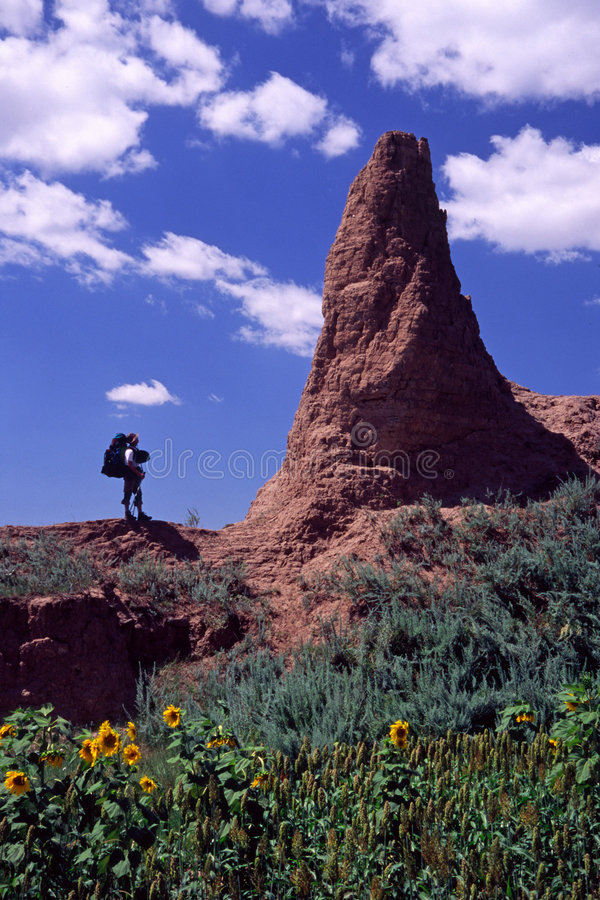 Hiker and collapsed watchtower stock photo