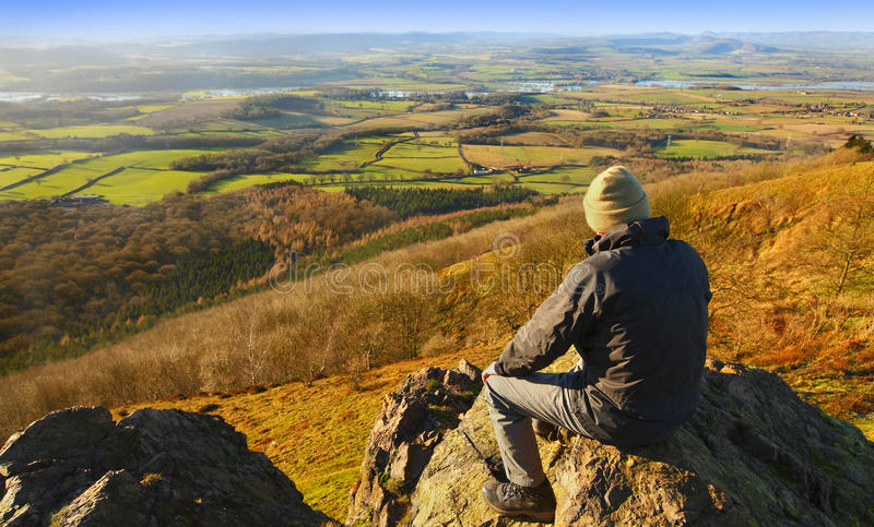 Hiker in countryside landscape stock image
