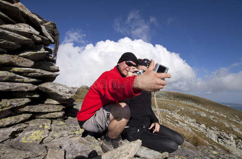 Hiker couple taking pictures