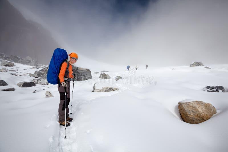 Hiker crosses Cho La pass in Khumbu valley, Nepal royalty free stock photos