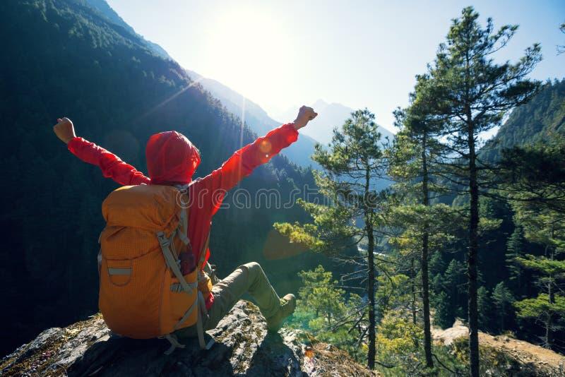 Hiker enjoying the sunrise in the himalaya mountains. Happy woman hiker enjoying the sunrise in the himalaya mountains royalty free stock image