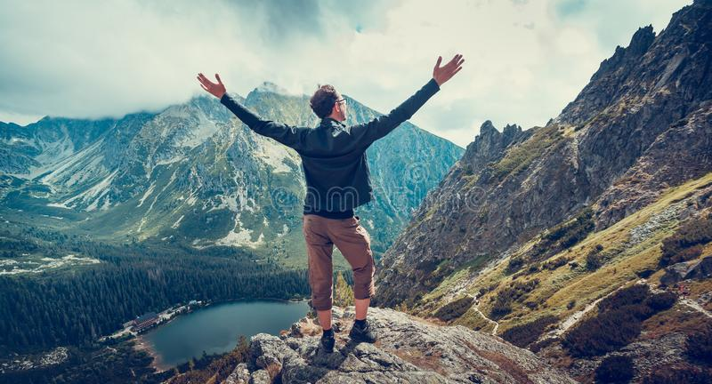 The hiker enjoys the panoramic view. The Tatras. royalty free stock image