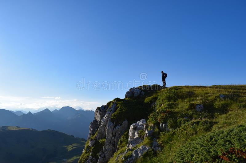 Hiker in front of a cliff stock photo