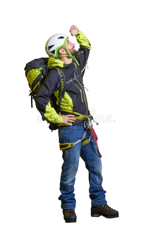 Hiker in full equipment looking up. Smiley hiker in full equipment looking up. isolated on white background royalty free stock photo