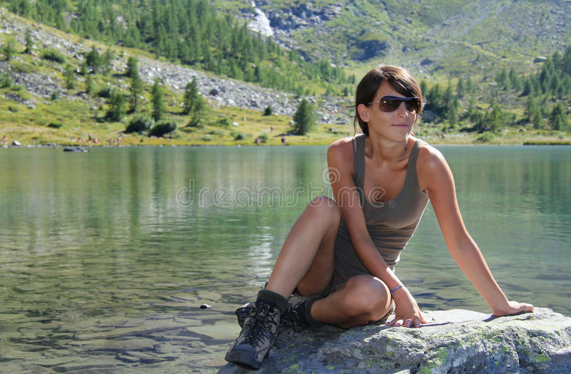 Download Hiker Girl Poses By An Alpine Lake Stock Photo - Image: 28719506
