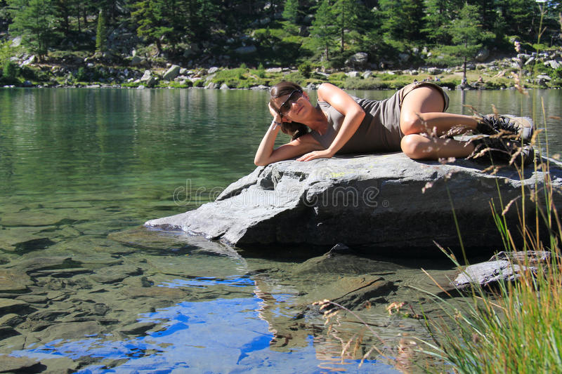 Download Hiker Girl Relaxed On A Stone By A Lake Stock Photo - Image of female, arpy: 28719676