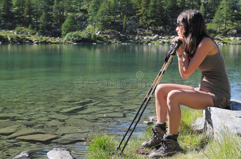Download Hiker Girl Seated On A Stone Stock Photo - Image: 28719722
