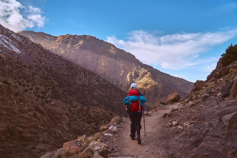 Tourist descending from Jebel Toubkal back to Imlil royalty free stock images