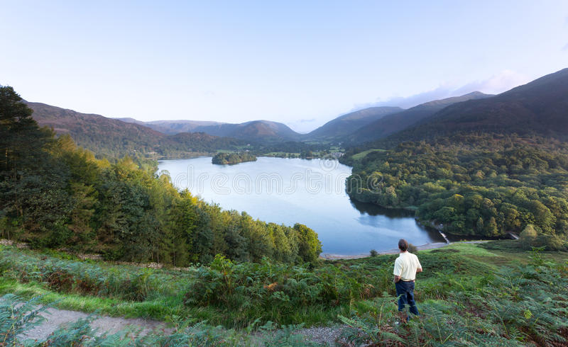 Hiker At Grasmere At Dawn In Lake District Stock Photo