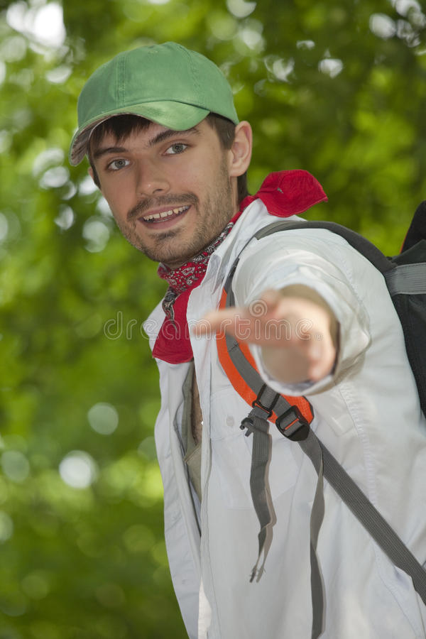 Hiker helping. Male hiker handed someone a helping hand stock photography