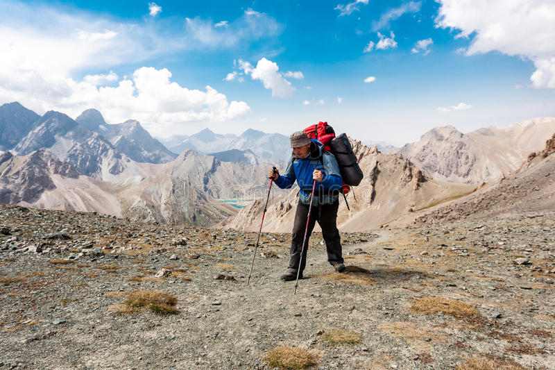 Hiker in high mountains. stock photography