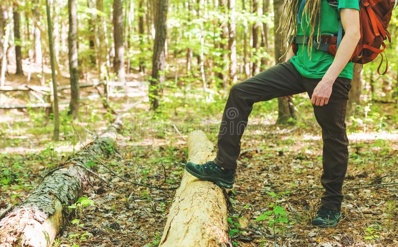 Hiker in hiking boots in the forest. Hiker in hiking boots standing in the forest stock photography