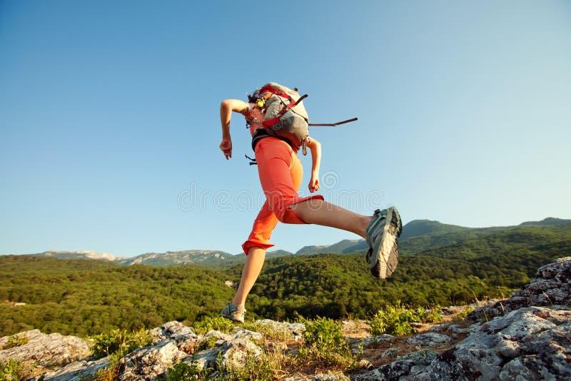 Hiker jumps stock photos