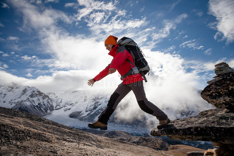 Hiker jumps on the rock near Everest in Nepal royalty free stock images