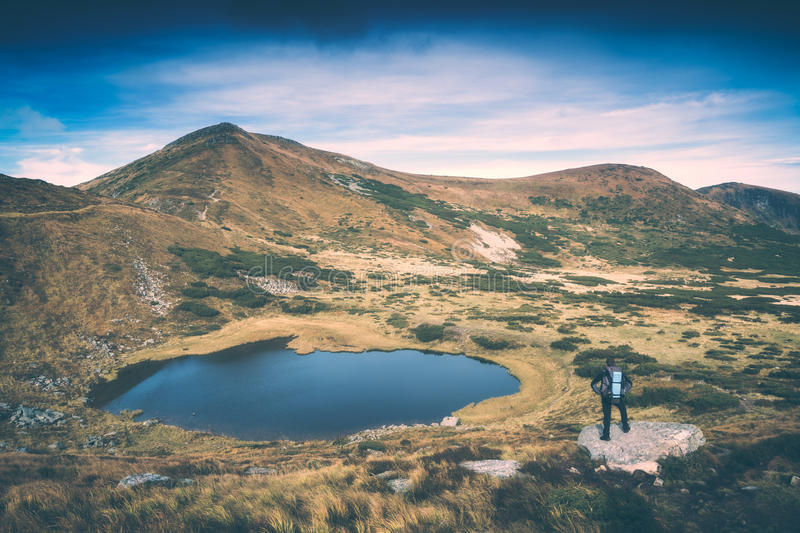 Hiker and the lake. Instagram stylisation royalty free stock photo