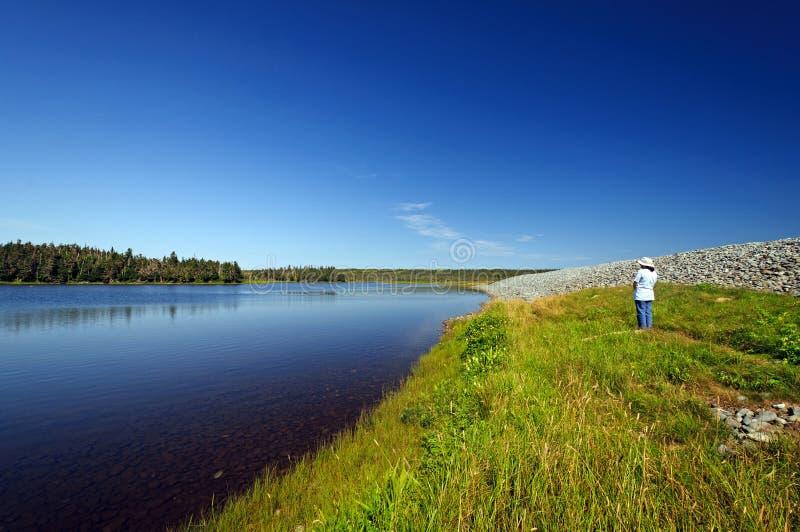 Download Hiker Looking At A Coastal Lagoon Stock Image - Image: 26225759