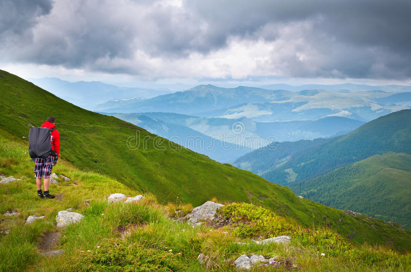 Hiker looking in the distance royalty free stock photography