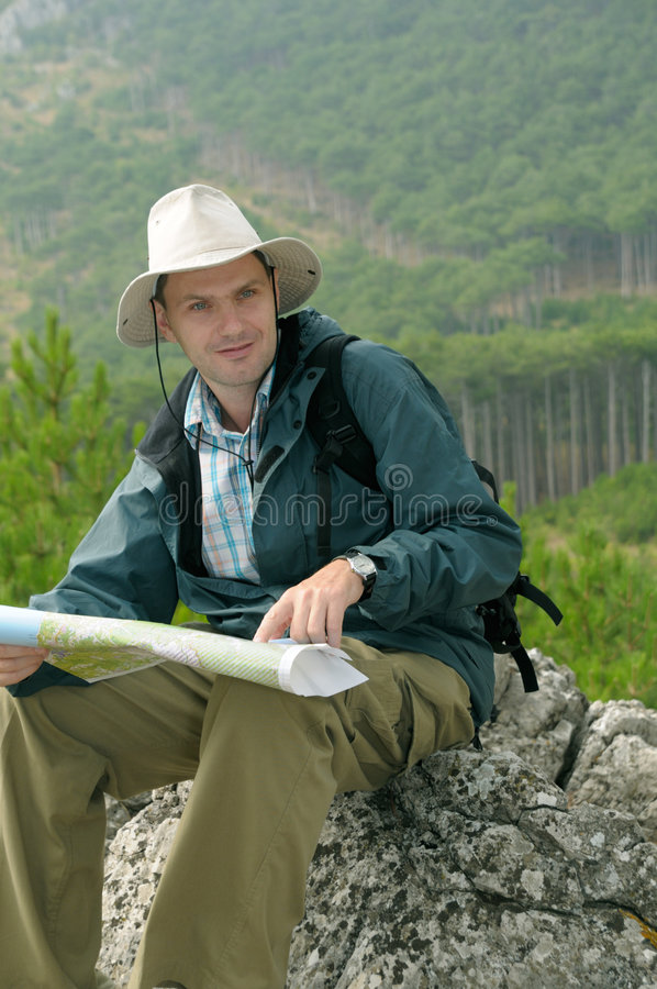 Hiker looking at a map while out trekking stock photo