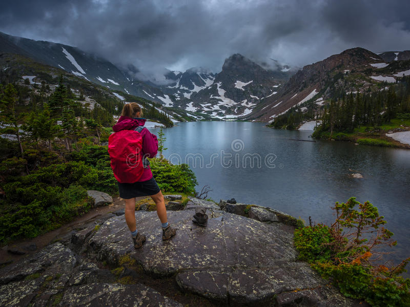 Hiker looks at Lake Isabelle Brainard Lake Recreation Area. Backpacker looks at Lake Isabelle Brainard Lake Recreation Area Colorado Tourism stock photos