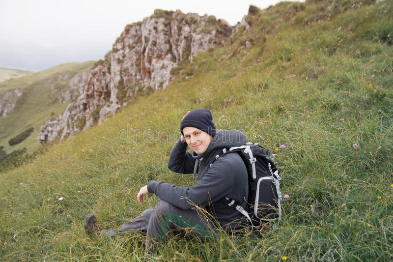 Hiker man relaxing in mountains royalty free stock photos