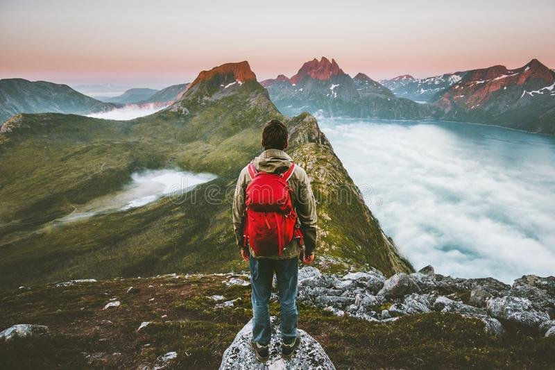 Hiker man exploring sunset mountains with backpack stock photo