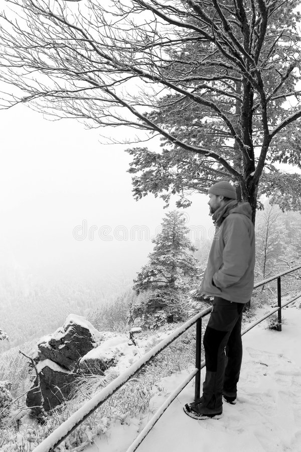 Hiker in the mist royalty free stock image
