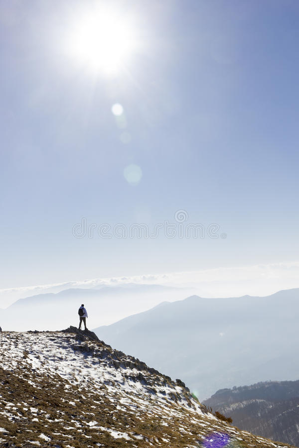 Hiker on mountain royalty free stock photo