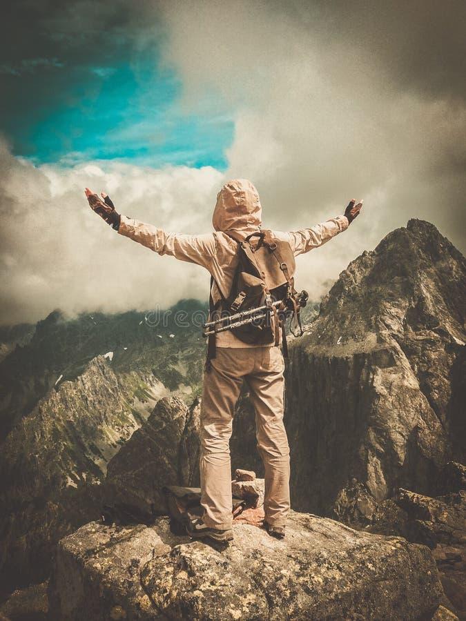 Hiker on a mountain stock photo